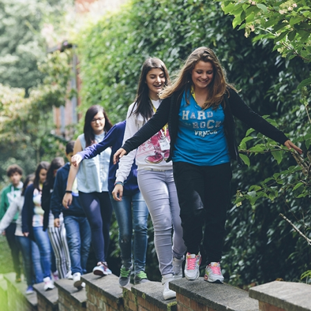Students walking up wall